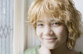 Biracial young teen girl smiling, closeup — Stock Photo