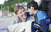 Father enjoying beach with disabled son — Foto de Stock