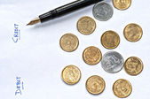 Accounting sheet pen paper and coins, isolated, copy space — Stock Photo
