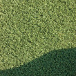 Artificial grass fake turf synthetic lawn field macro closeup wi — Stock Photo