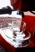 Glass cup and espresso machine — Stock Photo