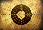 Target with bullet holes over grunge background — Stockfoto