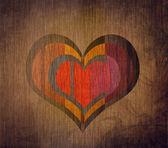 Grunge pozadí s červeným srdcem v centru — Stock fotografie