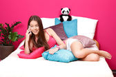 Nice teenager making a call in her bed — Stock Photo