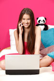 Cute girl smiling and making a call in her pink room — Stock Photo