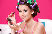 Portrait of a young teenager doing her makeup at home — Stock Photo