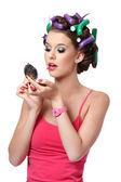 Portrait of a girl applying lipstick — Stock Photo
