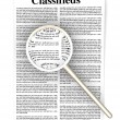 Searching the Classifieds - Lizenzfreies Foto