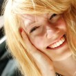 Smiling young woman in the sunlight - Stock Photo
