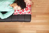 Jung brazilian woman sleeping on the sofa — Stock Photo