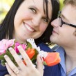 Attractive Young Man Gives Flowers to His Love — Stock Photo