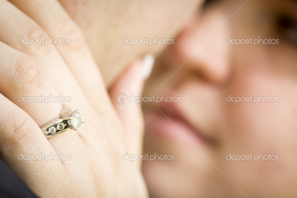 Young Female Hand with Engagement Ring Touching Fiance's Face with Selective Focus on the Ring. — Stock Photo #11135150