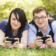 Young Couple at Park Texting Together — Stock Photo