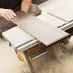 Contractor Using Circular Saw Cutting of New Laminate Flooring — Stock Photo