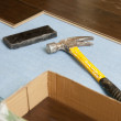 Hammer and Block with New Laminate Flooring — Stock Photo #11301089