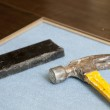 Hammer and Block with New Laminate Flooring — Stock Photo #11301093