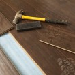 Hammer and Block with New Laminate Flooring — Stock Photo #11301101