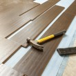 Hammer and Block with New Laminate Flooring - Stock Photo