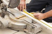 Contractor Measuring for Cutting New Baseboard for Renovation — Stock Photo