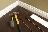 Push Broom on a Newly Installed Laminate Floor and Baseboard — Stock Photo