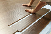 Man Installing New Laminate Wood Flooring — Stock Photo