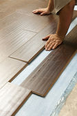 Man Installing New Laminate Wood Flooring — Stock Photo