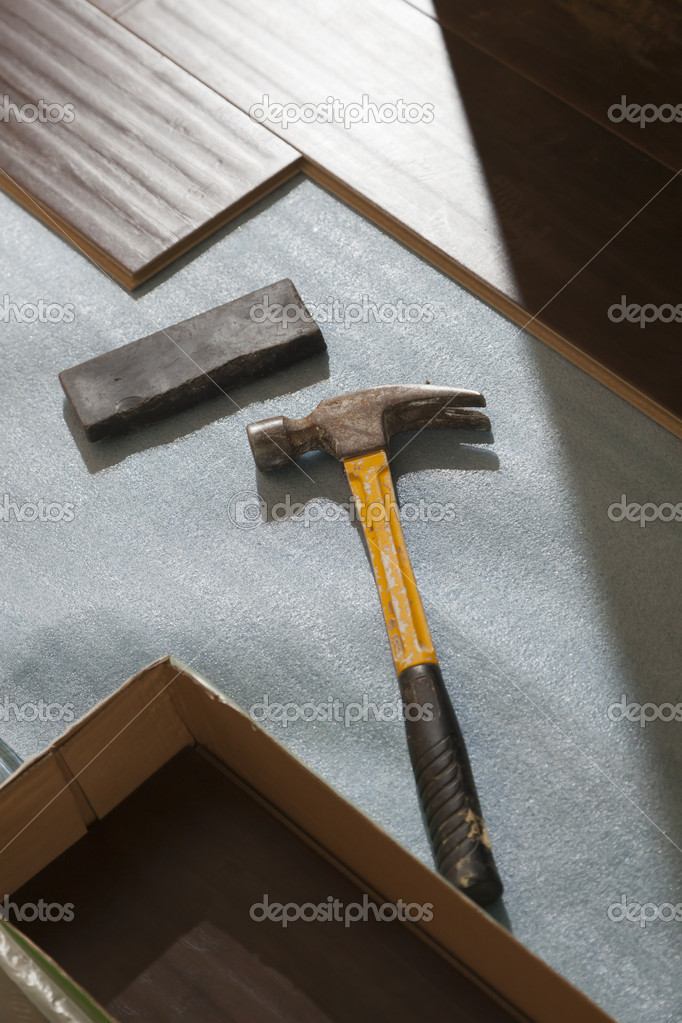 Hammer and Block with New Laminate Flooring Abstract. — Stock Photo #11301095
