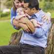 Happy Mixed Race Family with a Baby Boy Enjoying The Park — Stock Photo