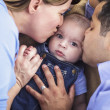 Mixed Race Parent Kissing Their Son — Stock Photo #11382005