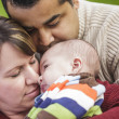 Happy Mixed Race Parents Hugging Their Baby Son — Stock Photo #11382020