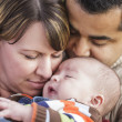 Happy Mixed Race Parents Hugging Their Son — Stock Photo