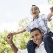 Hispanic Father and Son Having Fun in the Park — Stockfoto