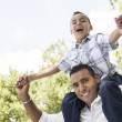 Hispanic Father and Son Having Fun in the Park — Stock Photo #11470704