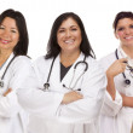 Three Hispanic Female Doctors or Nurses on White — Stock Photo #11470737