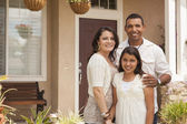 Small Hispanic Family in Front of Their Home — Stock Photo