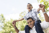 Hispanic Father and Son Having Fun in the Park — Stock Photo