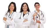 Three Hispanic Female Doctors or Nurses on White — Stock Photo