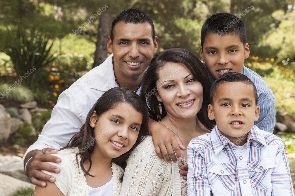 Happy Attractive Hispanic Family Portrait Outdoors In the Park.  Stock Photo #11470702