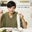 Mixed Race Young Female Agonizing Over Financial Calculations - Stockfoto