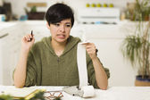 Mixed Race Young Female Agonizing Over Financial Calculations — Stock Photo