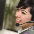 Attractive Young Mixed Race Woman Smiles Wearing Headset — Stock Photo #11512196