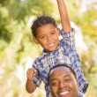 Royalty-Free Stock Photo: Mixed Race Father and Son Cheering with Fist in Air
