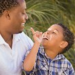 Royalty-Free Stock Photo: Happy Mixed Race Father and Son Playing