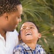 Stock Photo: Happy Mixed Race Father and Son Playing