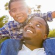 Royalty-Free Stock Photo: Mixed Race Father and Son Playing Piggyback