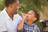 Happy Mixed Race Father and Son Playing — Stock Photo