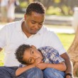 African American Father Worried About His Mixed Race Son — Stock Photo