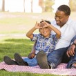Mixed Race Father and Son Making Heart Hand Sign — Stock Photo