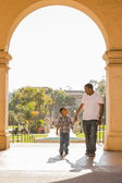 Mixed Race Father and Son Walking in the Park — Stock Photo