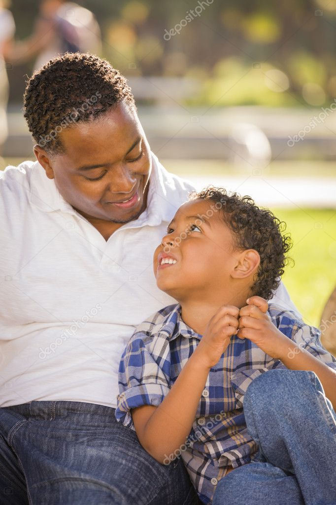 Happy African American Father and Mixed Race Son Playing in the Park. — Stock Photo #11584927